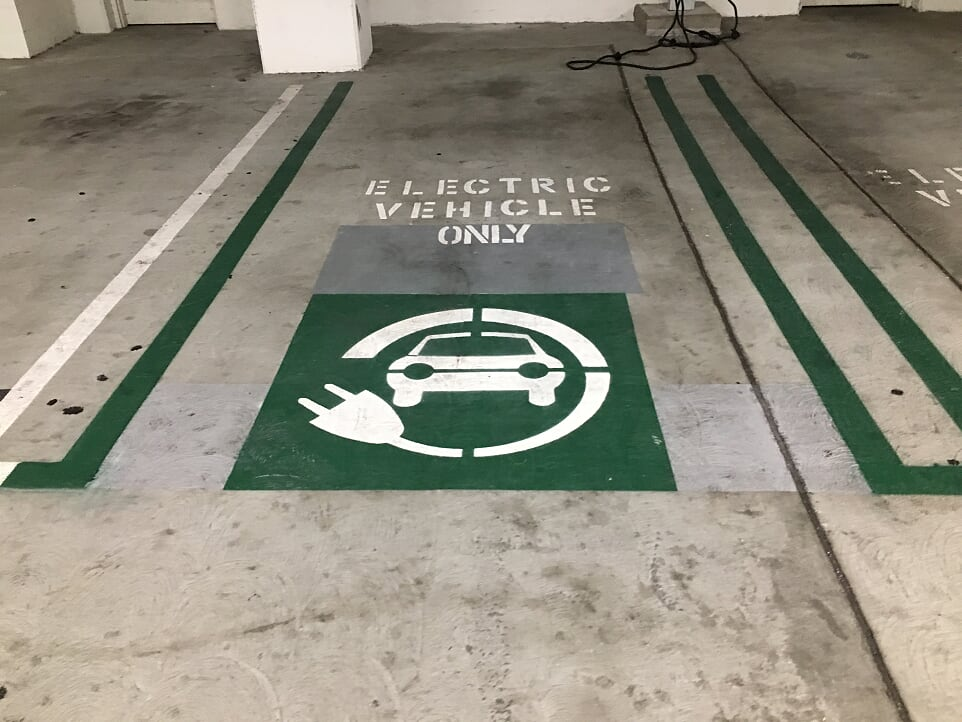 Electric Vehicle Stencil and Striping In Parking Lot Irving, TX